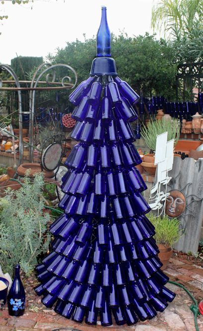 Blue Bottle Tree. This is amazing! Check out the other ideas using a blue bottle. What a great site.