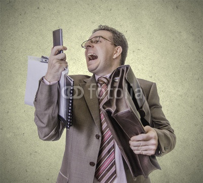 Angry businessman screaming at smartphone on white background