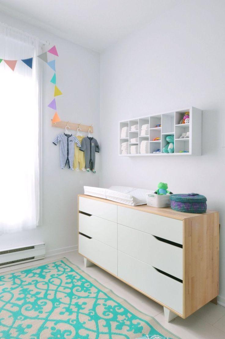 STUVA crib; Ikea MANDAL dresser, Ikea Garland; DIY POÄNG rocking chair; Ikea Chevron gray and white throw; West Elm Plastic rug; Fab Habitat Colorful rug; Home Depot Moroccan pouf; Ikram Design