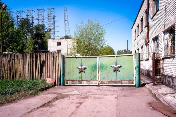 Eerie photographs have capture the abandoned remains of a 'hidden town' surrounding a mysterious group of antennas - which were abandoned 30 years ago following the Chernobyl disaster.The incredible …