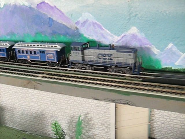 https://flic.kr/p/ccabSL |  EMD Diesel  Switcher & Wooden coach's.
