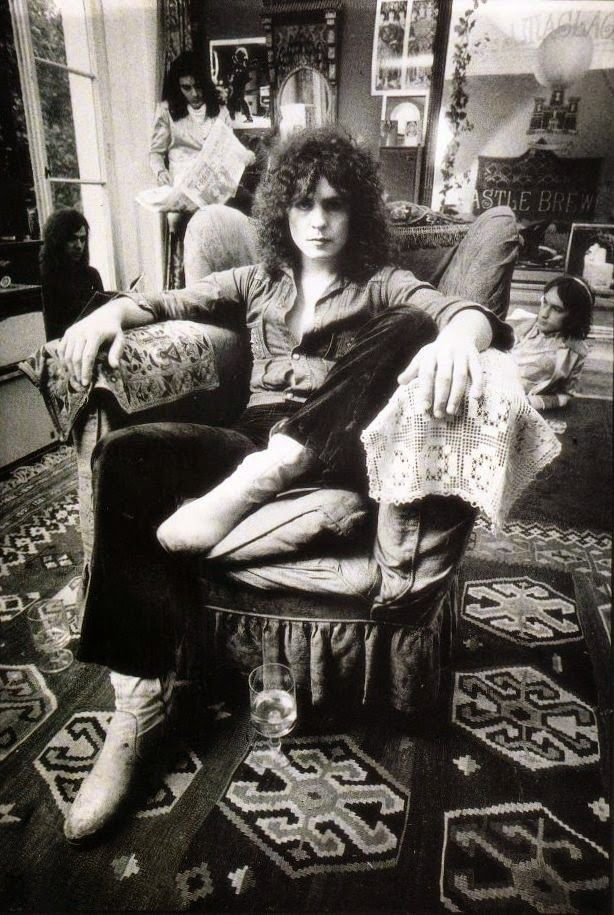"""Marc Bolan and his T. Rex band mates Mickey Finn, Steve Currie and Bill Legend as they are about to release the album Electric Warrior, which is among the best of Bolan's varied output.   The photos were taken by Kieron """"Spud"""" Murphy, who was also responsible for the original photo used as the image for the cover of Electric Warrior."""