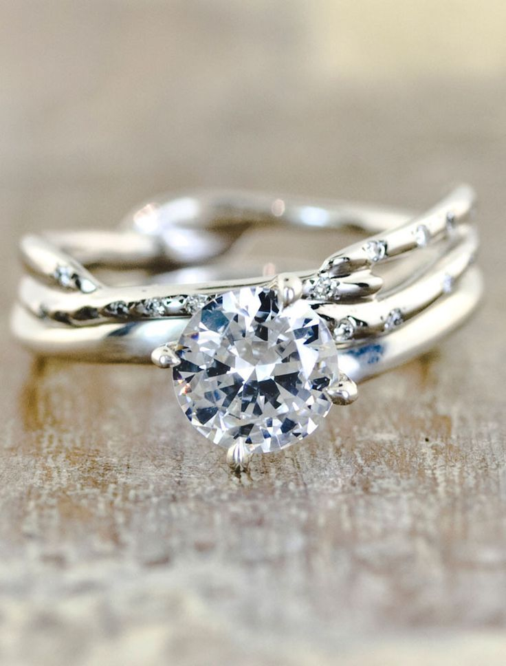 The Aurora engagement ring with the Selene Wedding band. Honey- this is the one. Look, there's a even the link ;)