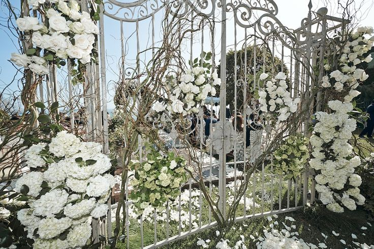 Guests entered the alfresco ceremony through a wrought-iron gate embellished with vines, branches, and lush flowers, including hydrangea blossoms and roses. #EntranceDecor Photography: Daniel Kincaid Photography. Read More: http://www.insideweddings.com/weddings/brittney-palmer-and-aaron-zalewski/595/
