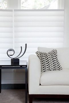 Striking black and white interior with top-down, bottom-up Hunter Douglas Vignette® Modern Roman Shades ♦ Hunter Douglas window treatments #LivingRoom