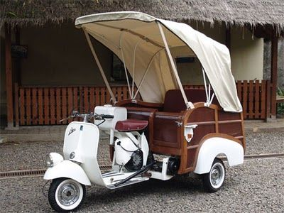The lovely Vespa Ape Calessino, a popular Mediterranean runabout from the '50s, would be ideal.
