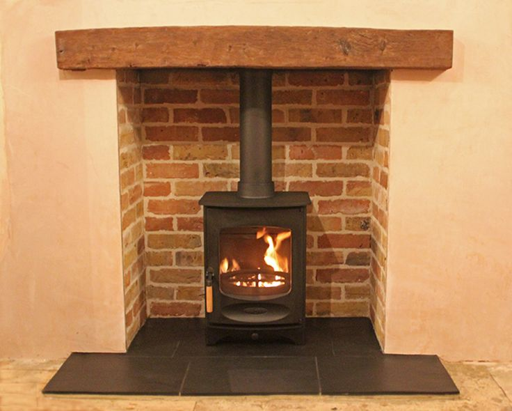 Reclaimed brick slip chamber with slate tiled hearth, reclaimed clad oak beam and Charnwood C4 wood stove fitted in Stratford London E20 2012