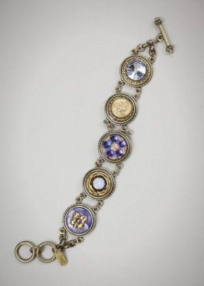 Marais bracelet:  Vintage dyed pearl button; new Czech glass button; antique brass button circa 1880-1900; Swarovski crystals in light sapphire and air blue opal.