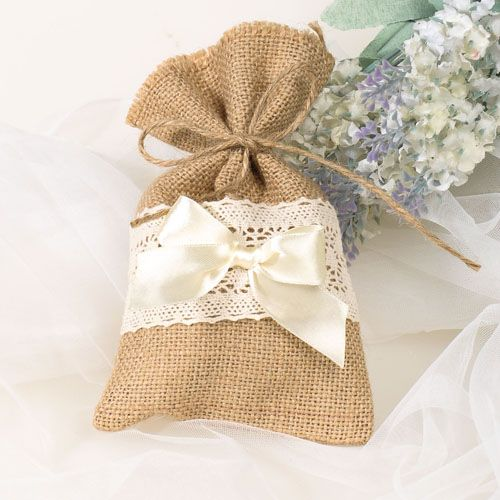 Country burlap style gift bags made with a delicate lace and satin bow applique. These nifty little bags are gorgeous for so many themed weddings and look ever so elegant.