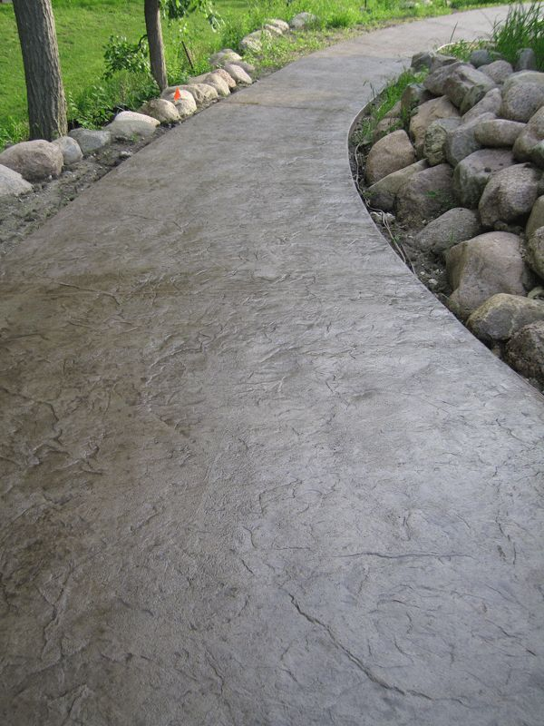 Decretive textured concrete sidewalk / accessible home wheelchair path. Would love this verse a ramp
