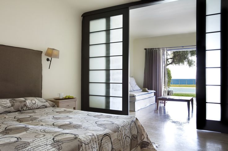 Sea view suite with sharing pool at Minos Palace in Crete.