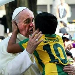 Embraces and cries with a young boy who told him he wants to be a priest