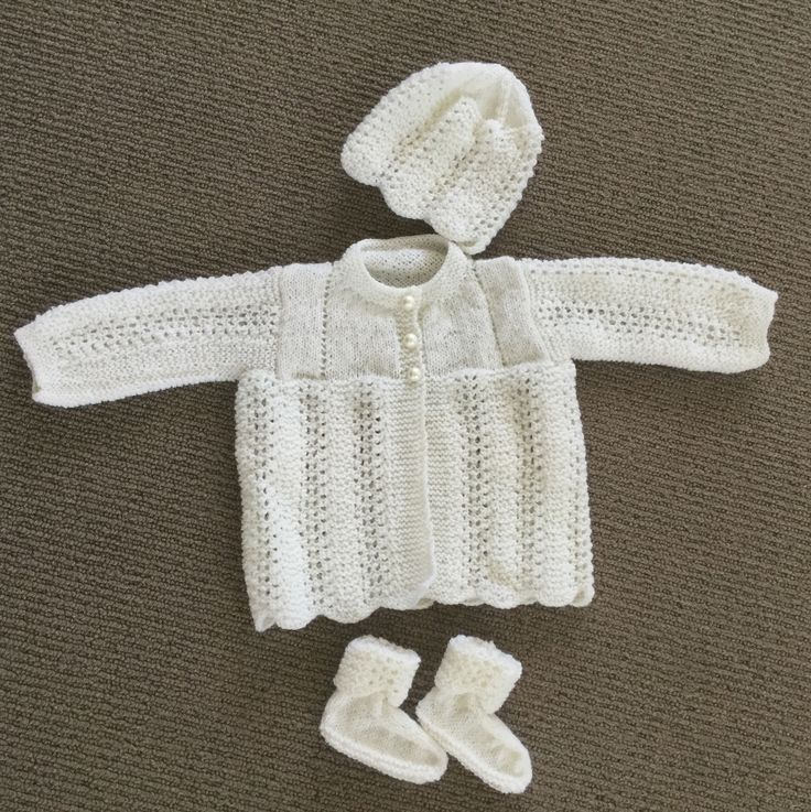 This pattern is based on the original feather and fan stitch layette set which included the circular shawl.  Knitted in 3 ply merino wool.  The matinee jacket is knitted in feather stitch with an eyelet pattern in the yoke and scallop edging. The bonnet is sewn to become a beanie and the bootees have a rib band so no need for ribbons.