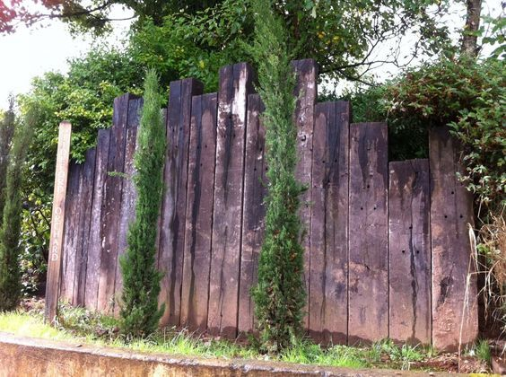 Tideford Orchard vertical entrance wall with used railway sleepers