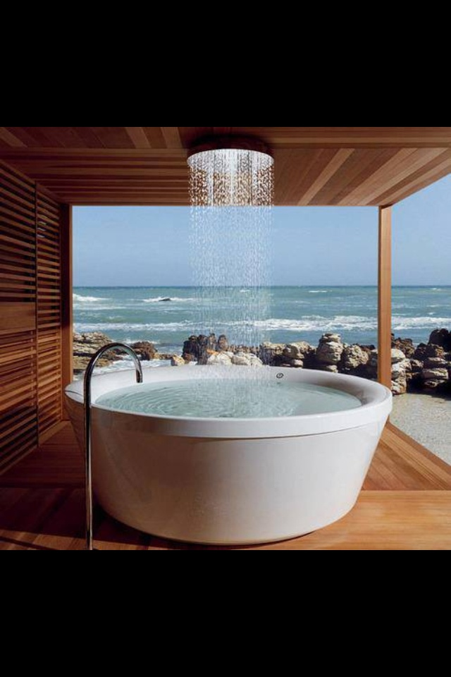 Soaker tub for two with a ceiling tub filler! A sophisticated and contemporary look! Would be amazing to enjoy the beach views in