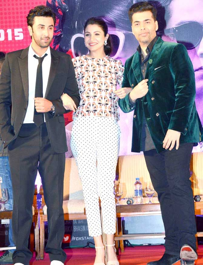 Ranbir Kapoor, Anushka Sharma and Karan Johar strike a pose for the shutterbugs at the second trailer launch of their film 'Bombay Velvet'. #Bollywood #Fashion #Style #Beauty