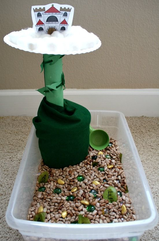 When telling simple stories create a sensory bin to engage the children, give them each a turn to visit the sensory bin. The example in the picture is a jack and the beanstalk sensory bin.