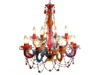Sick and tired of the traditional #chandelier? This colorful beauty adorned with plastic #crystals will make a more unique alternative! #color #lights #lighting #pretty