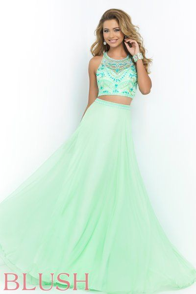 Blush Prom Dress Style 9916. This jaw dropping Honeydew two piece features a sleeveless bateau neckline. The bodice and thin straps along the back are covered in dazzling jewel accents and color coordinating beadwork while the layered floor length A line skirt is crowned with matching beads. Come see us at Rubie&Jane in Lufkin, TX for Prom 2015!