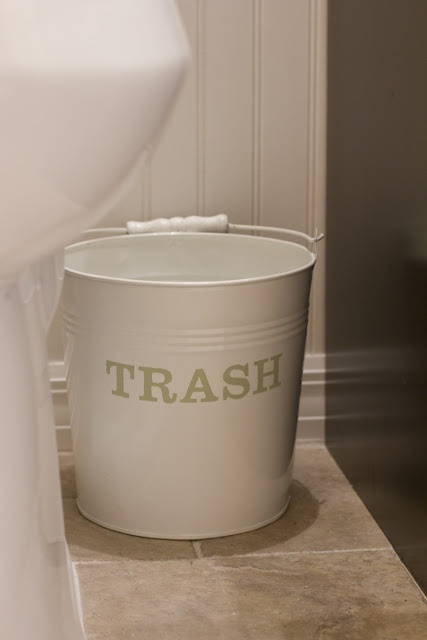 Use a metal bucket for the kids bathroom trash - easier cleanup and so cute, too!