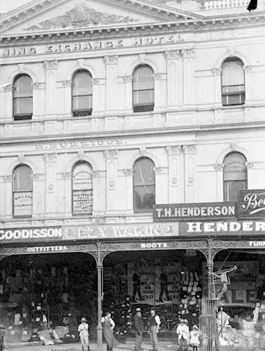 The Mining Exchange Hotel with the shops of Henderson & Goodisson Beehive Stores and Ezywalkin Boots. Pall Mall, Bendigo, Victoria, Australia, 1890 W H Robinson Studio, 1890