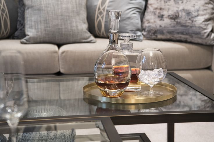 Chic and refined, this beautiful decanter sits upon this antique style glass coffee table inviting you to be sociable in our elegant Buckinghamshire #drawingroom. #interiordesign #luxurylife #luxury #london #luxuryproperty #luxuryhomes #londonproperty #luxuryinteriors