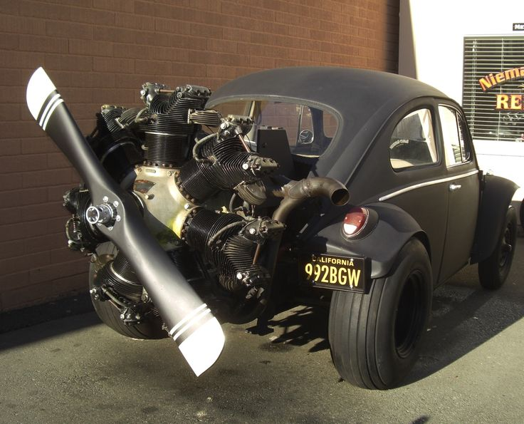 VW with radial engine. We once had a guy put a windup key on our VW like this but this is a lot more impressive!