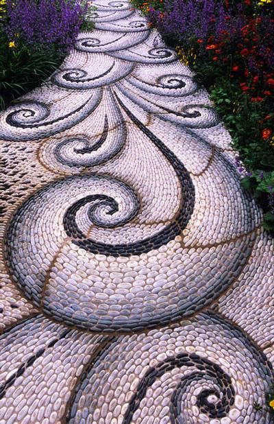 I've always wanted to make a mosaic pebble path.  Justin and I saw some a while back, maybe in Spain? and thought they were so unique and beautiful.