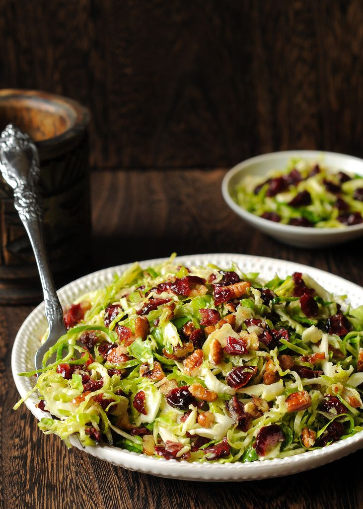 This delicious salad is all about crisp Brussels sprouts tossed together with dried cranberries and chopped pecans in honey mustard vinaigrette.