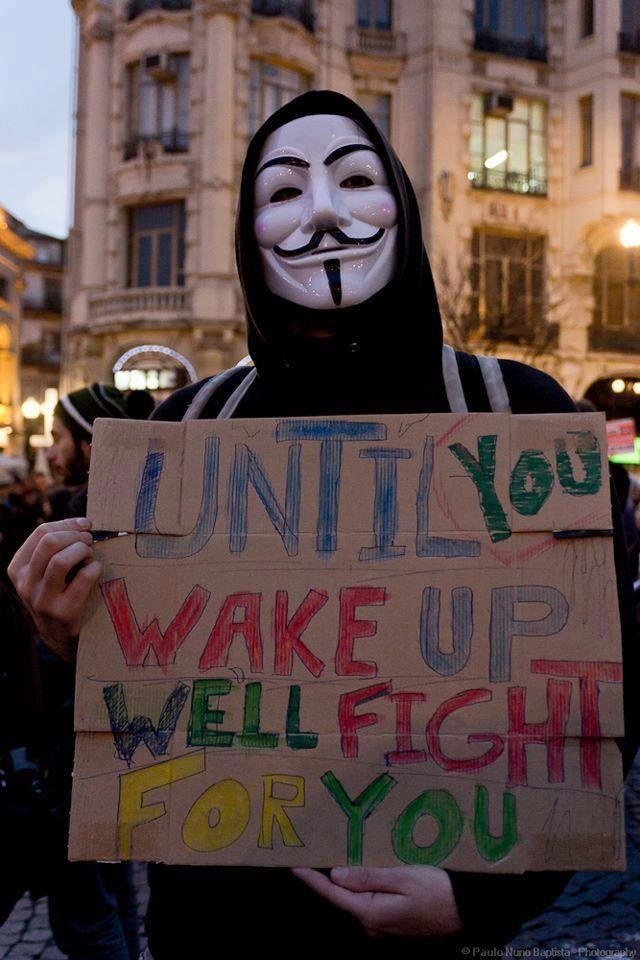 Anonymous in Guy Fawkes mask: 'Until you wake up we'll fight for you.'