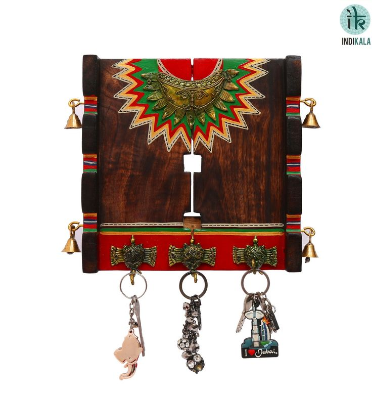 Handcrafted with Dhokra work and bright hues. This Half Sun Key Ring Holder has 3 Elephant Key Pegs. Four Bells add to the sheen. An elegant addition to your wall.