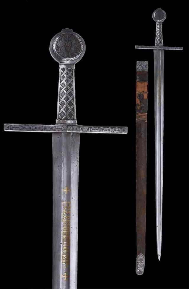 "An Eastern European Medieval Sword with Scabbard, first half of the 14th century The hilt all encrusted with silver (niello). The blade inlaid with gilt inscriptions. The upper back side of the blade engraved with a Mameluk inscription (arsenal of Alexandria). Leather bound scabbard with silver mounts. Overall length: 105.3 cm (41.5""); Blade length: 88.4 cm (34.8""); Scabbard length: 89.5 cm (35.2"") Located at Reichsstadtmuseum Rothenburg, Germany."