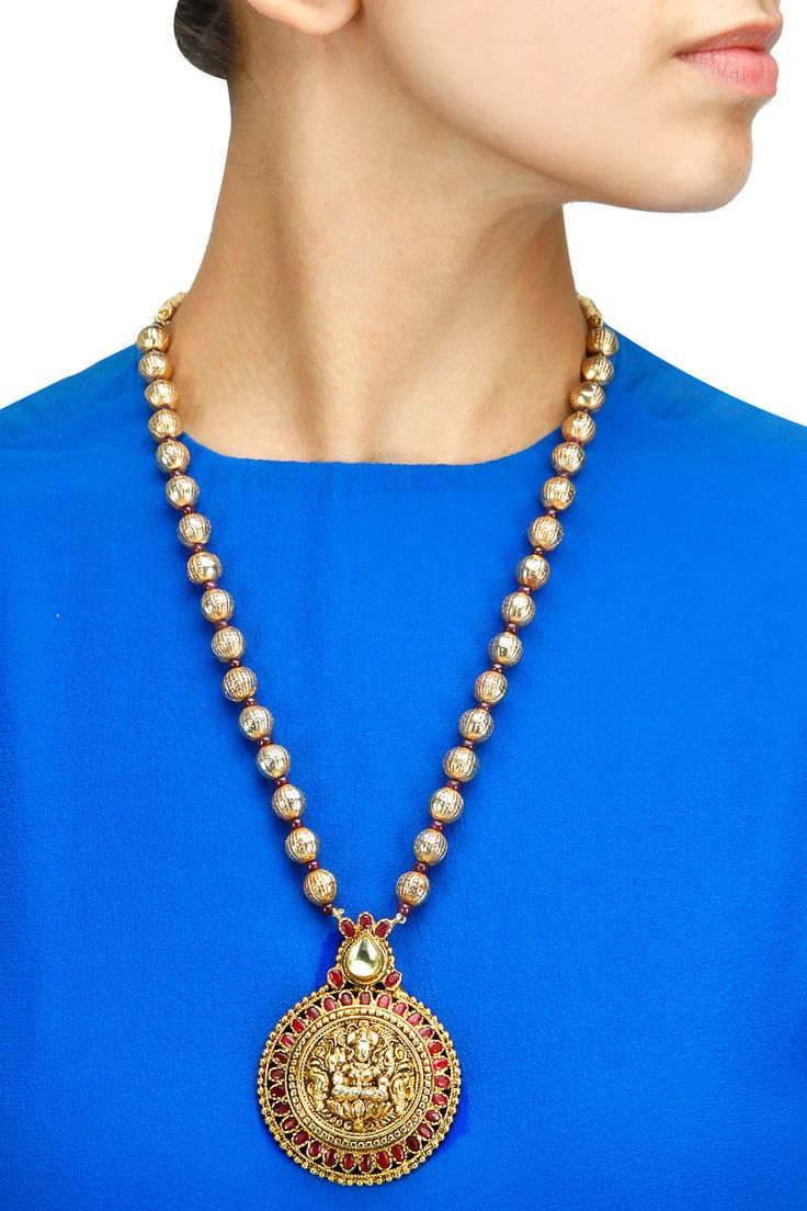 Gold plated goddess lakshmi necklace available only at Pernia's Pop-Up Shop.