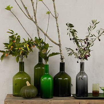Glass Bottle Vases #westelm; color of choice; like green botanicals. more masculine than flowers.