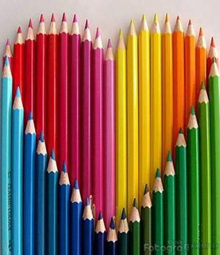 Colored pencils in the shape of a heart.