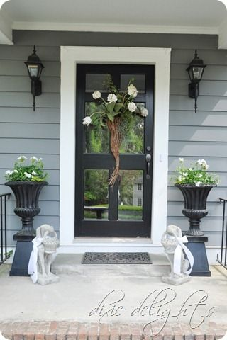 love this front porch and door. see also dixie delights wreath that can be changed for different times of year -