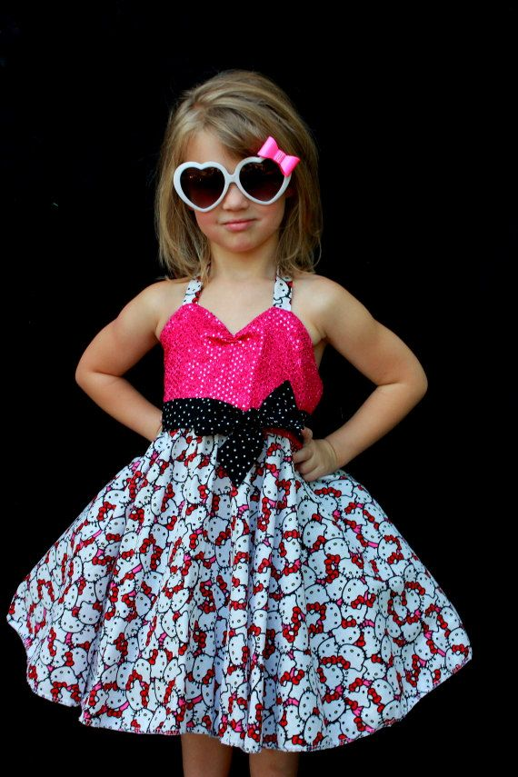 This is a cotton toddler dress. It has a Sequin pink bodice, tie neck halter black polka dot sash and a full circle skirt. this dress would be