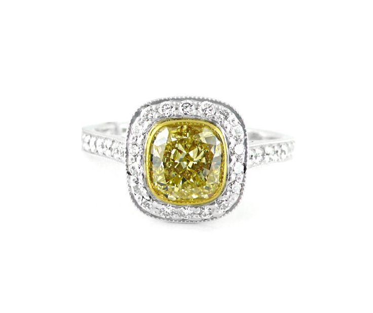 An 18ct Yellow and White Gold Yellow Cushion Cut Diamond Halo Ring
