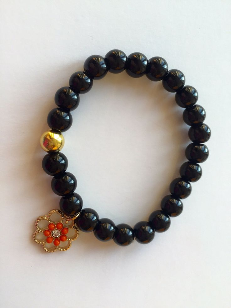 Bracelet made of Black Onyx Semi Precious, Flower Charm ,Unique Jewellery by BarbarittasBoutique on Etsy