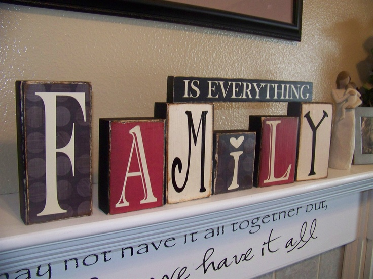 Family Is Everything Vinyl Lettering Blocks along with the script on a ledge