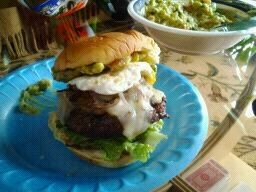 Grilled burger seasoned with Worcestershire sauce. Topped with grilled ...