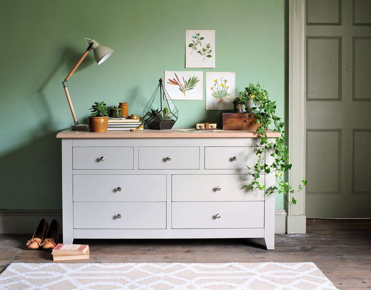 Botanical prints,Country living, modern Country, country style, rustic bedroom, green walls, styling with plants, terrarium, grey furniture, dream bedroom