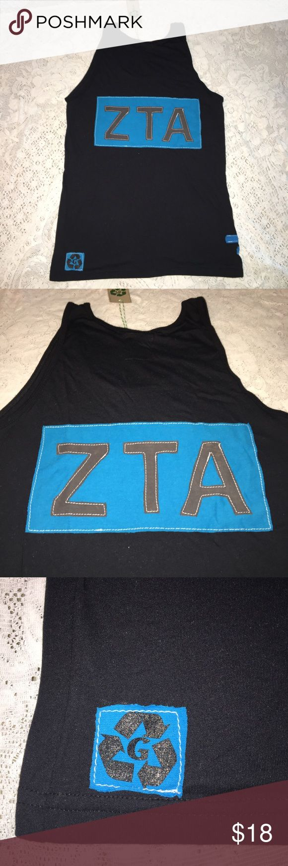 NWT Zeta Tau Alpha black and teal sorority tank M NWT Zeta Tau Alpha black & teal scoop neck tank top. Size AM. 50% cotton & 50% polyester. Teal sorority logo symbol on back. Solid front. Made in USA. $36 retail. Rare and one of a kind. #greek #life #college #university #zeta #tau #alpha #sorority #pledge #teal #black #big #little #sister #nwt #tank #new Never used. Smoke free home. Check closet for similar items & additional sororities. ❌no trades❌ FIRM Tops Tank Tops