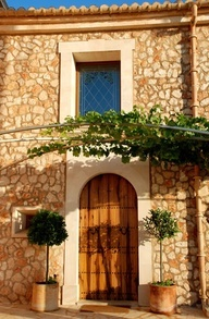 Antique wooden door & stained glass window: Hotel Migjorn, Campos, Mallorca, Spain - Photo Gallery