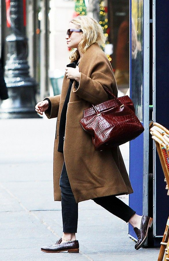 Chic oversized camel coat with slip-on loafers.