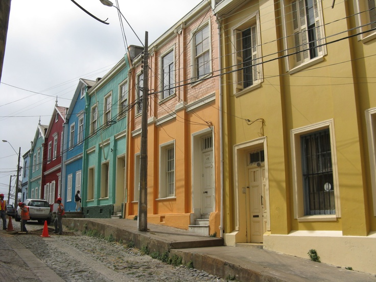 Colorfully painted homes being washed by the sun. Valparaiso, Chile