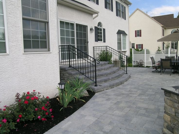Wide Custom Steps With A Large Landing In Front Of The