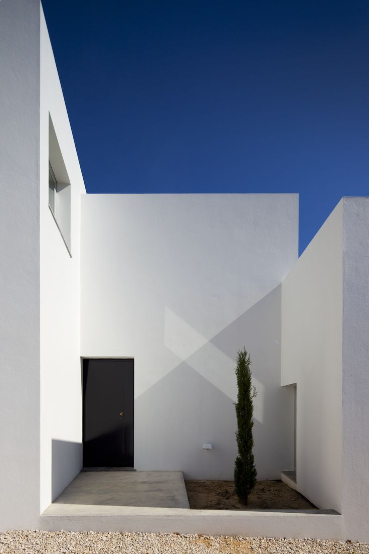 Three houses in meco is a residential project by portuguese studio dnsj arq on the outskirts of aldeia do meco southern portugal