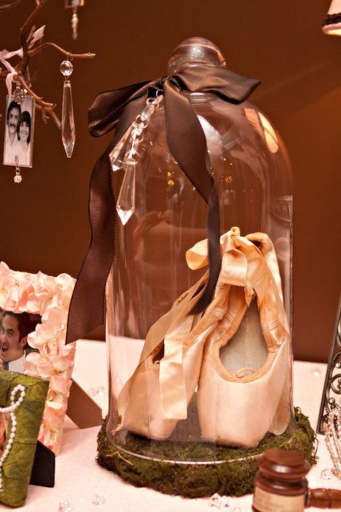 put ballet slippers or a special pair of high heels (maybe with glitter on them) under the glass and then use it as if it were a work of art for her room. Kind of gives that fairytale princess feel.