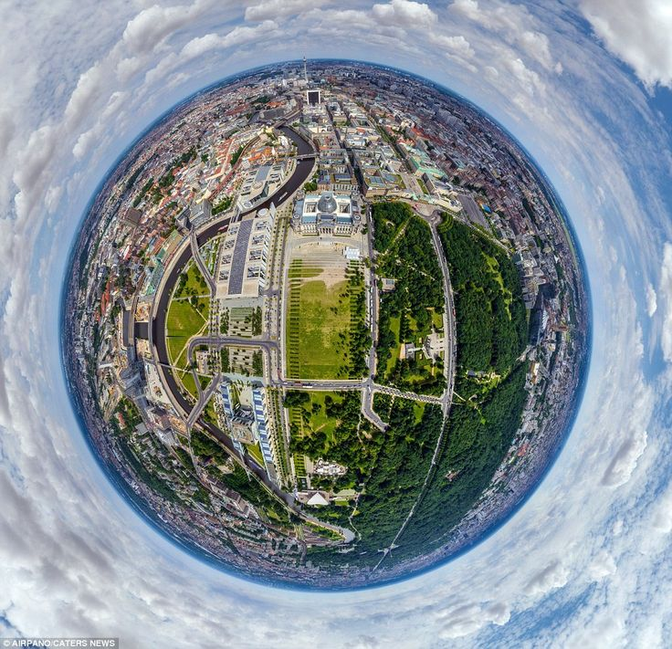 The historic Reichstag building is clearly visible in this image of the Platz der Republik...